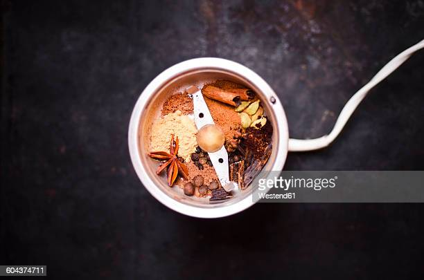 Preparing gingerbread spice with coffee mill