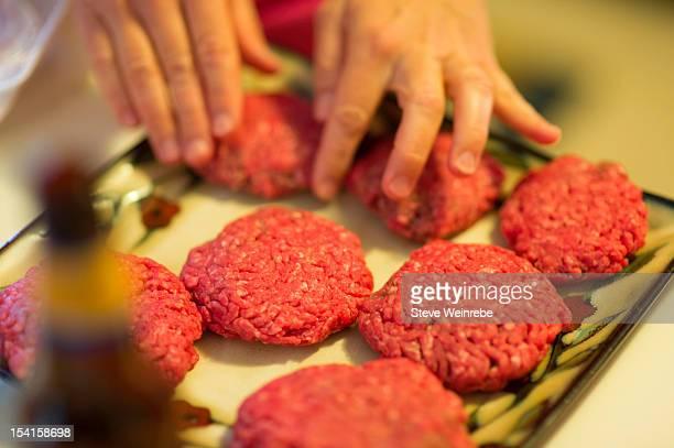 Preparing hamburger patties for grilling