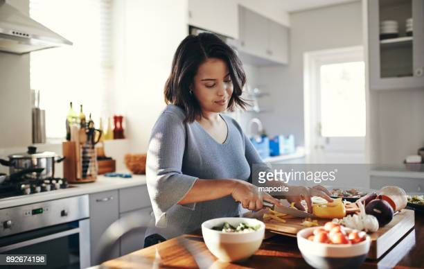 preparing her favourite dish - healthy lifestyle stock pictures, royalty-free photos & images