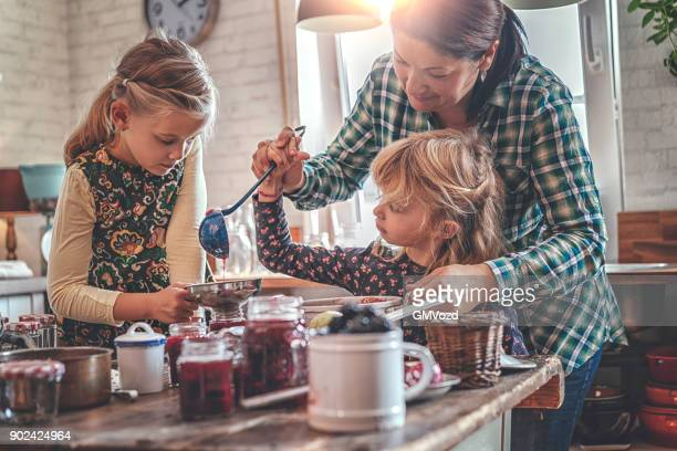 preparing homemade berry jam and canning in jars - preparation stock pictures, royalty-free photos & images