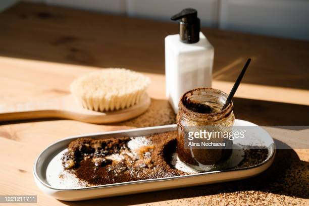 preparing homemade coffee scrub at home - exfoliation stock pictures, royalty-free photos & images