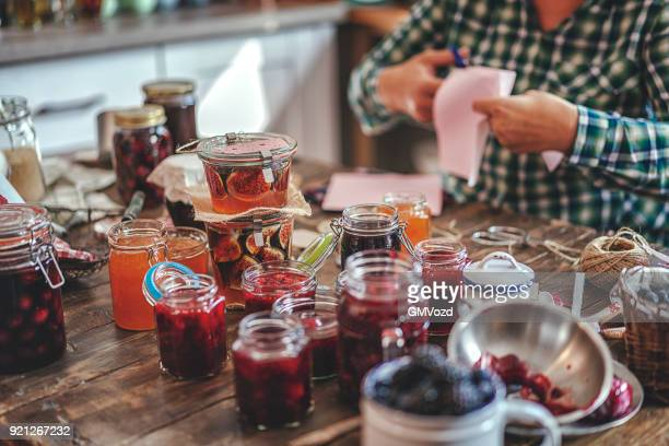 preparing homemade jam and canning in jars - jam stock pictures, royalty-free photos & images
