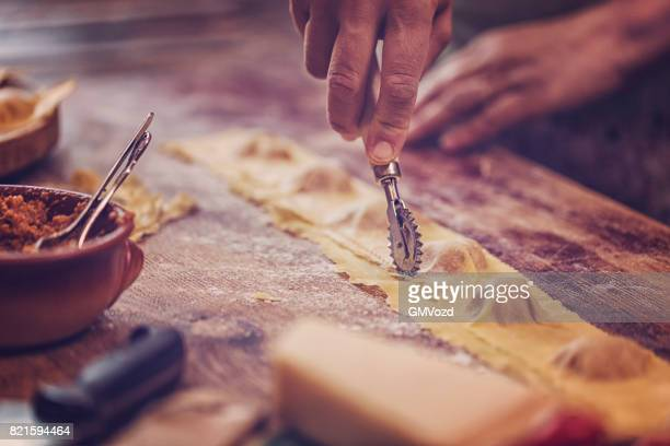 preparing homemade ravioli pasta - italian culture stock pictures, royalty-free photos & images