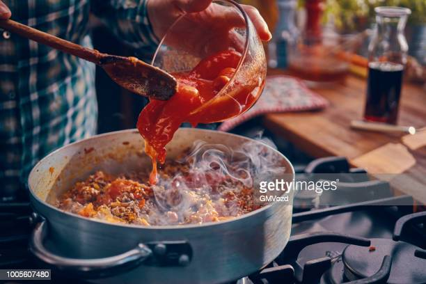 preparing homemade spaghetti bolognese - bolognese sauce stock pictures, royalty-free photos & images