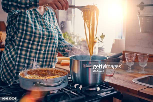 preparing homemade spaghetti bolognese - pasta stock pictures, royalty-free photos & images
