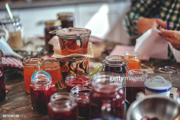 preparing homemade strawberry, blueberry and raspberry jam and canning in jars - jam stock pictures, royalty-free photos & images