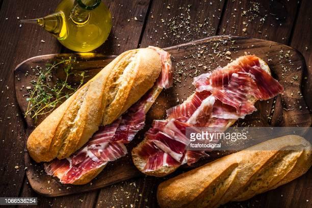 preparing iberico ham sandwich, spanish bocadillo de jamon iberico - serrano ham stock photos and pictures