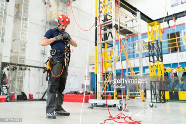 preparing industrial climber - high up stock pictures, royalty-free photos & images