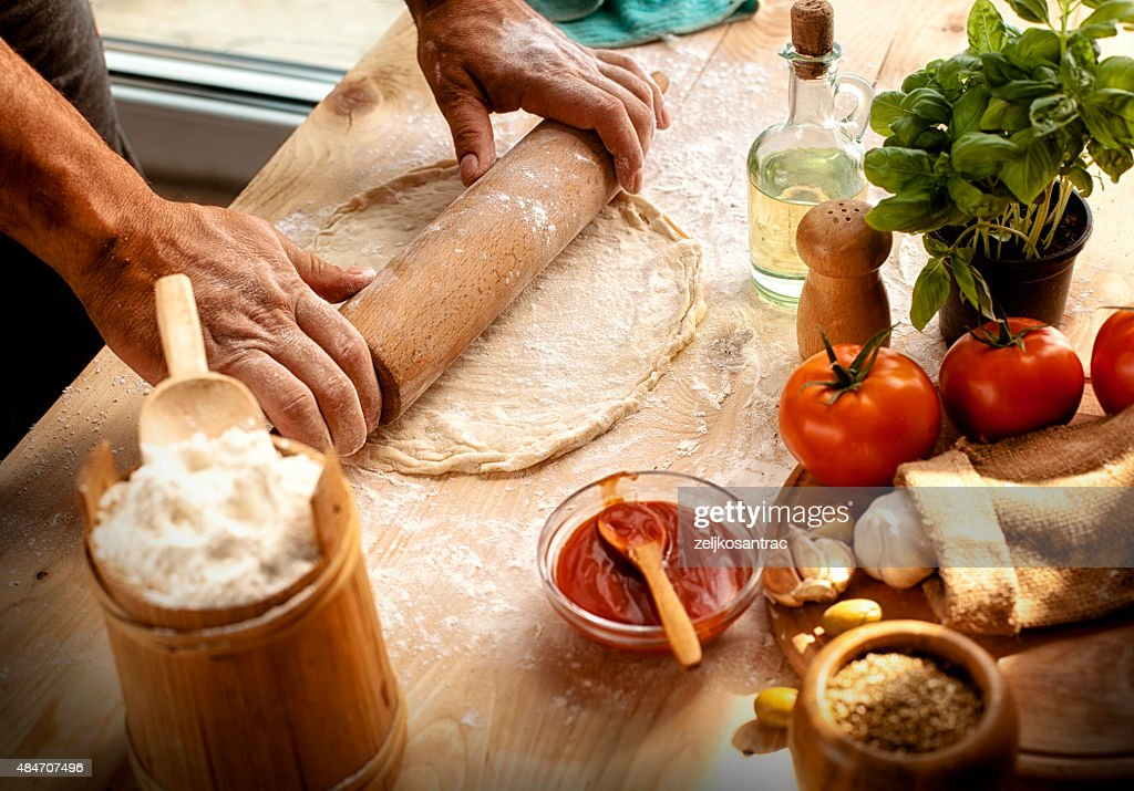 Preparing ingredients of homemade pizza : Stock Photo