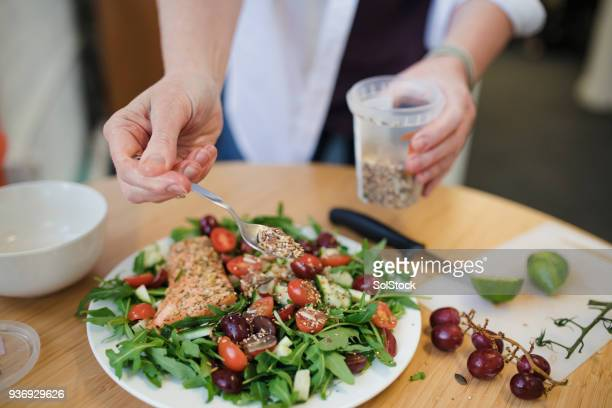 preparing lunch in the office - salad stock pictures, royalty-free photos & images