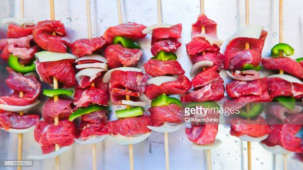 preparing meat steak with vegetables. - crmacedonio stock photos and pictures