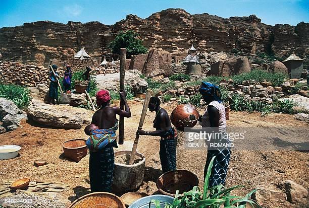 Preparing millet in the Dogon village of Ireli Mali