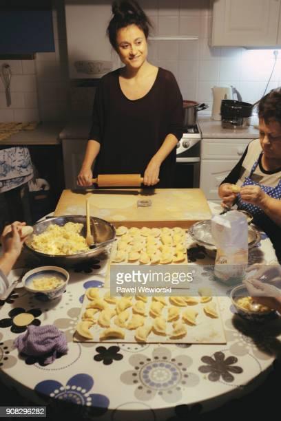 preparing pierogi - polish culture stock photos and pictures