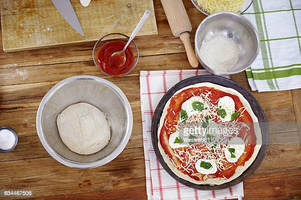 Preparing pizza in kitchen