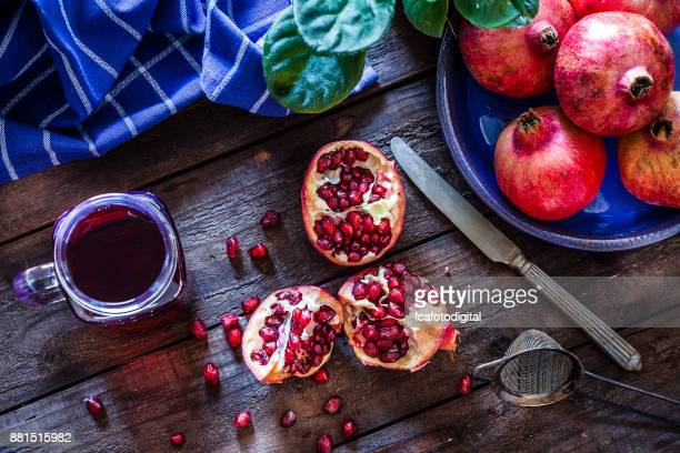 preparing pomegranate juice - pomegranate stock pictures, royalty-free photos & images