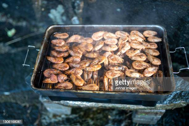 preparing prawns on grill - västra götaland county stock pictures, royalty-free photos & images