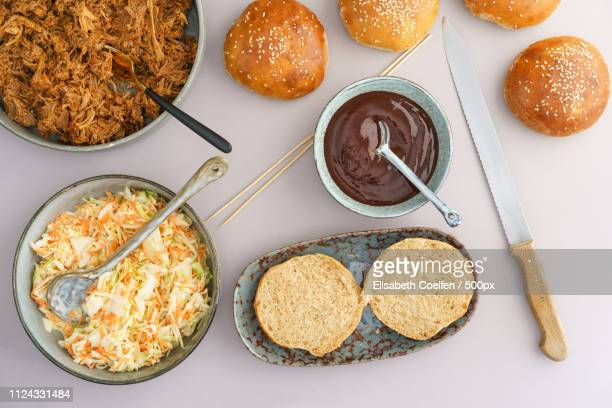 preparing pulled pork burger shot from above - barbeque sauce stock photos and pictures