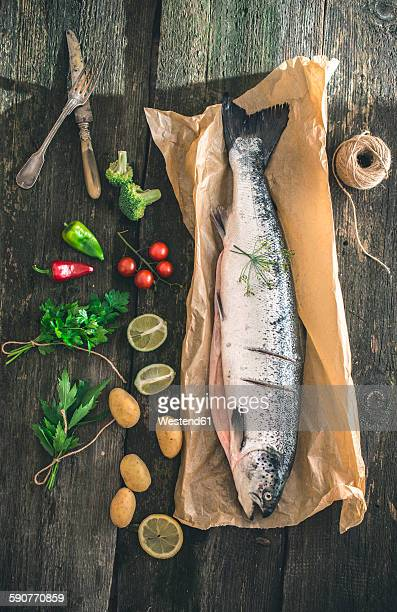 Preparing raw salmon for cooking