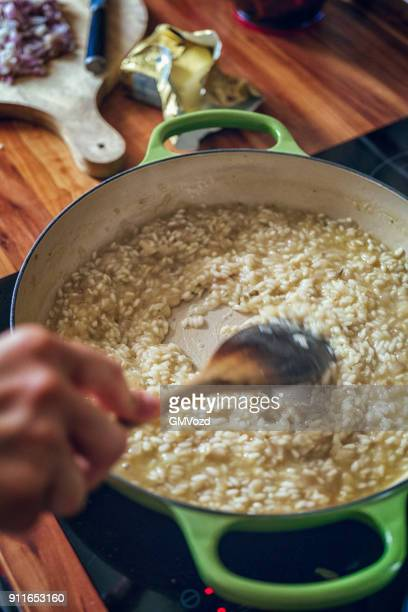 Preparing Risotto Bianco Served with Parmesan