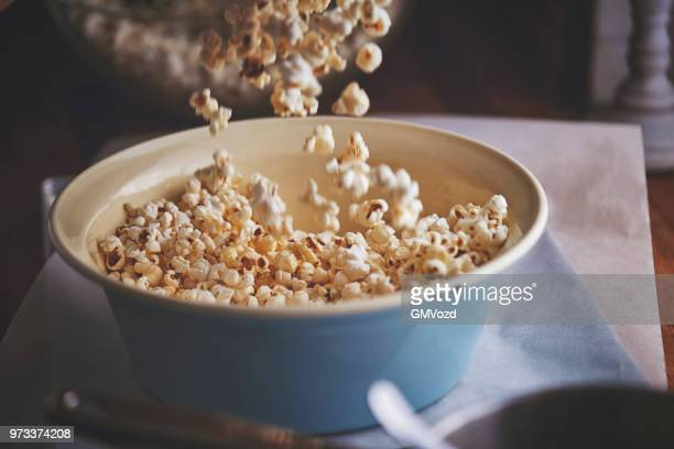 preparing salted caramel popcorn - home made stock pictures, royalty-free photos & images