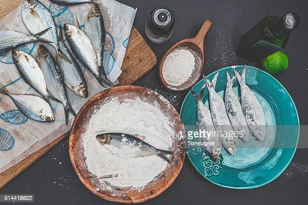 Preparing Sardines to Fry