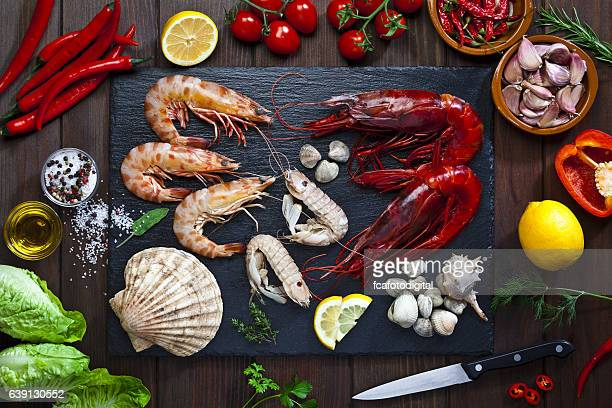 preparing seafood for cooking - seafood stock pictures, royalty-free photos & images