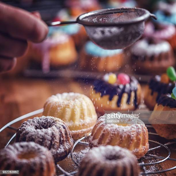 preparing small easter bunt cakes - easter candy stock pictures, royalty-free photos & images