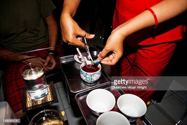 preparing snake blood to drink, mixed with blood from python, cobra, green mamba, gallbladder, sake, and redbull; a health remedy thought to heal many ailments. - gall bladder stock pictures, royalty-free photos & images