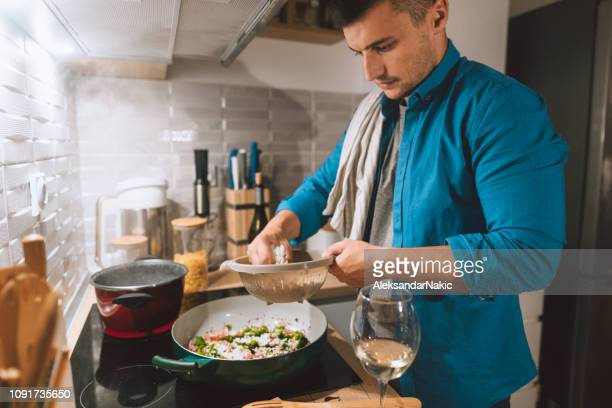 preparing some delicious risotto - hobbies stock pictures, royalty-free photos & images