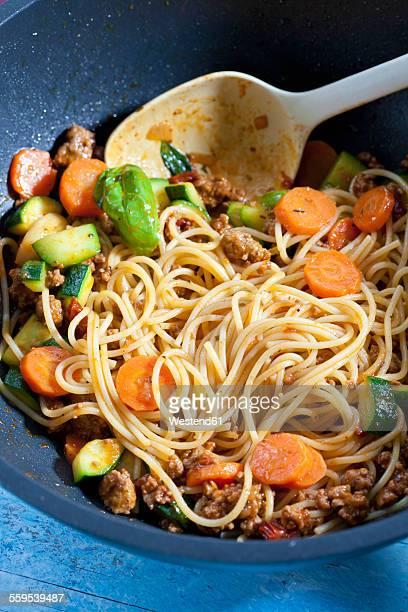 Preparing Spaghetti Bolgnese in a wok
