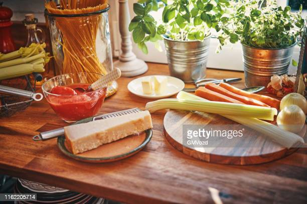 preparing spaghetti bolognese in domestic kitchen - parmesan stock pictures, royalty-free photos & images