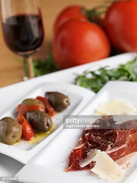 Preparing Spanish tapas. Selective focus on ham.  Shalloe deep of field. Spain 2008.