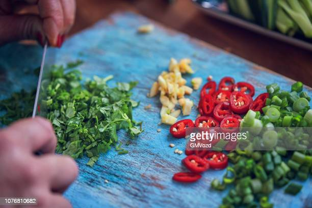 Preparing Spring Rolls with Vegetables and Shrimps