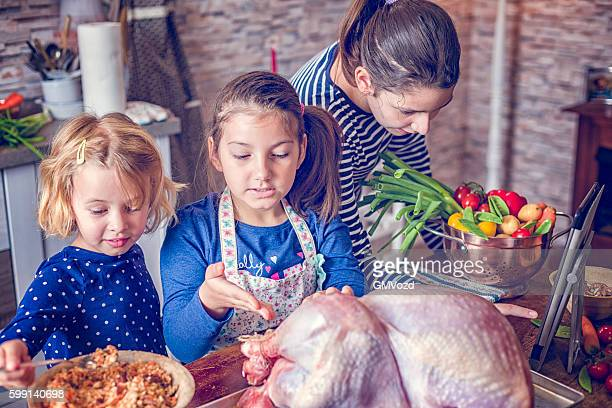 Preparing Stuffed Turkey with Vegetables for Holiday Dinner