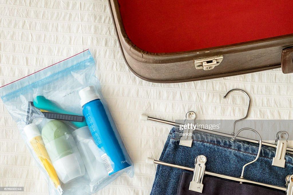 Preparing suitcase. Toiletry. : Stock Photo