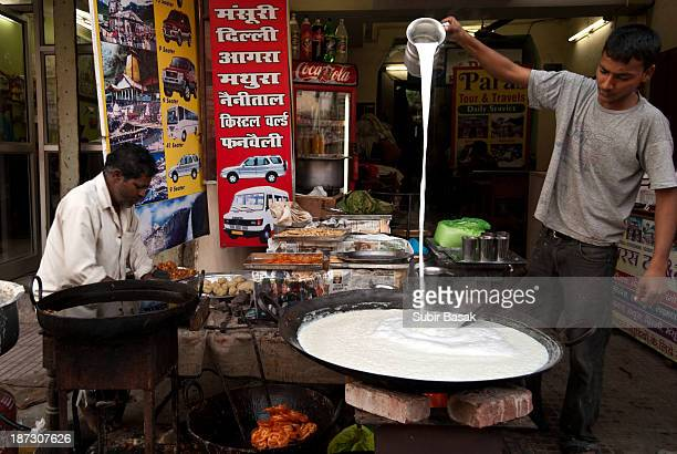 CONTENT] Preparing sweet milk in a stall on the streets of Haridwarstate of UttrakhandIndia on February 122010