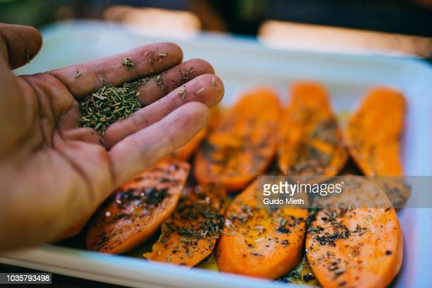 preparing sweet potato for bbq. - season stock pictures, royalty-free photos & images