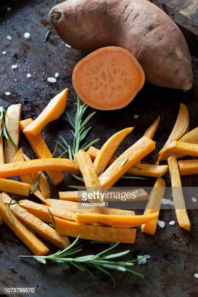 preparing sweet potato fries - fries stock-fotos und bilder