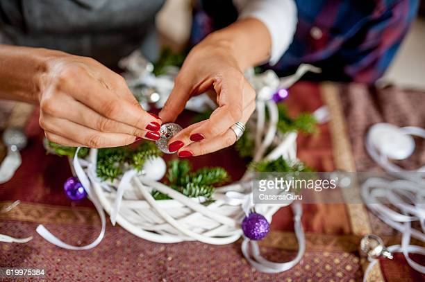 Preparing the Christmas Wreath