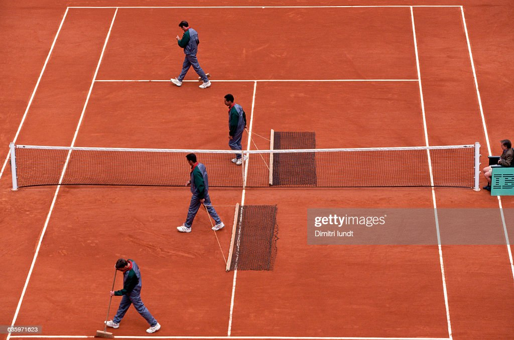 Preparing the clay courts for a match at the Roland Garros stadium, home of the French Open tennis tournament.
