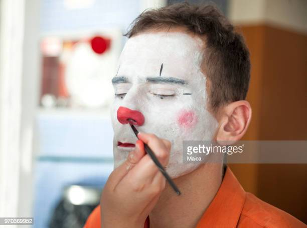 preparing the show clown - stage make up stock pictures, royalty-free photos & images