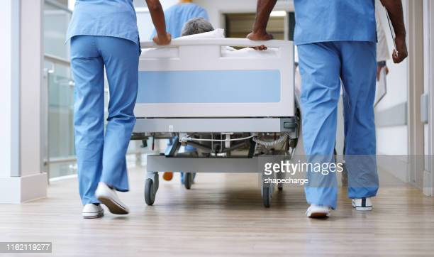 preparing their patient for the next operation - hospital stock pictures, royalty-free photos & images
