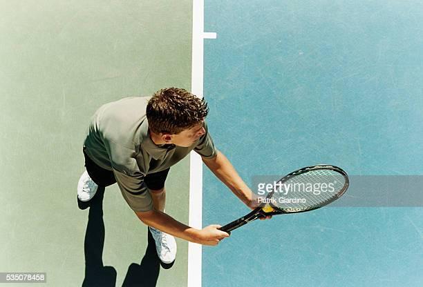 preparing to serve tennis ball - テニス ストックフォトと画像