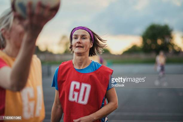 preparing to throw a netball - sporting term stock pictures, royalty-free photos & images