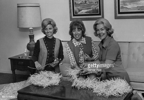 Preparing tumbleweeds as table decorations for the 'Silver Spring' luncheon and the ball are MrsRobert K Taylor left Mrs Fred F Meissner and Mrs K C...