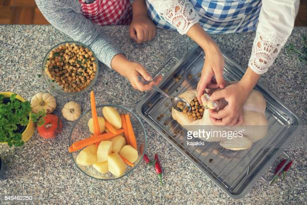 preparing turkey for thanksgiving dinner - stuffing stock photos and pictures