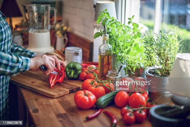 preparing vegetable gazpacho soup with tomato, cucumber, paprika and herbs - pureed stock pictures, royalty-free photos & images