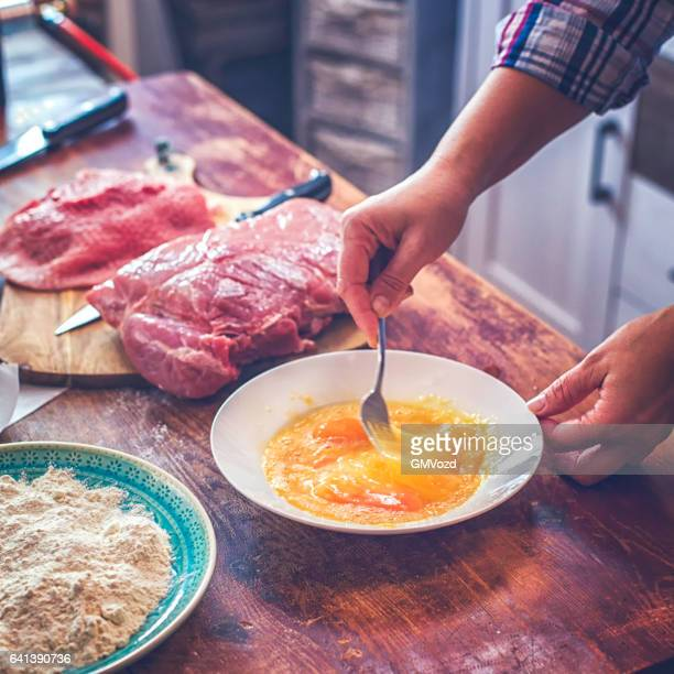 Preparing Wiener Schnitzel in Domestic Kitchen