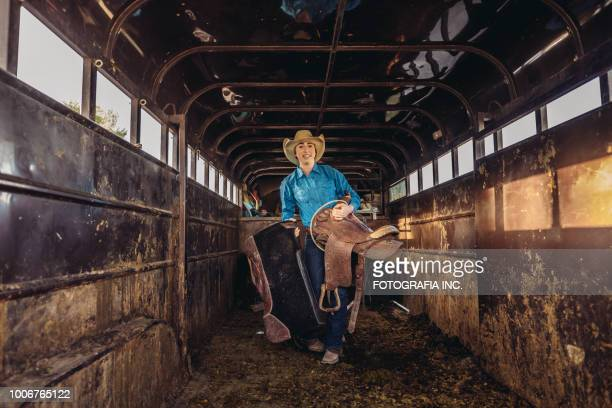 prepping for rodeo in utah - wet jeans stock photos and pictures