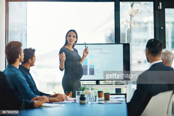 prepping her team for when she goes on maternity leave - maternity stock photos and pictures